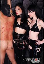 Cybill  mina black latex  cybill and mina have a new prospect for their stable but before he is initiated as a slave he must endure a whipping  the slave is restrained to the whipping post in the dungeon  mina and cybill dressed in lascivious matching lat. Cybill and Mina have a new prospect for their stable, but before he is initiated as a slave he must endure a whipping. The slave is restrained to the whipping post in the dungeon. Mina and Cybill dressed in lustful matching latex outfits with bullwhips in hand.